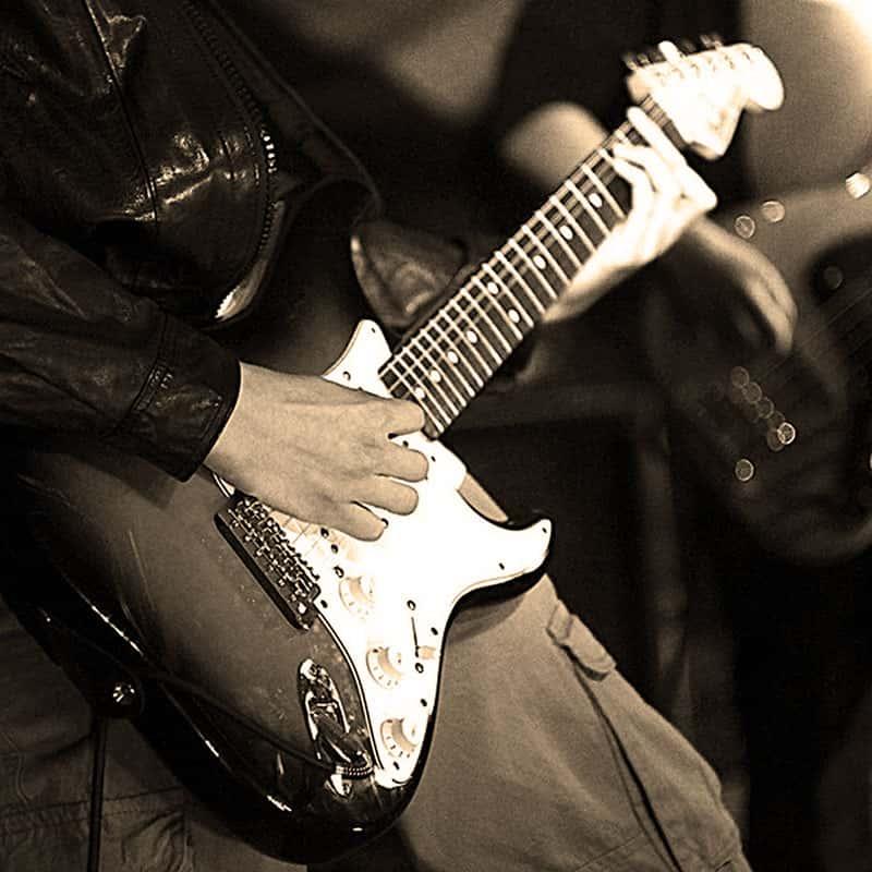 Illustration Top 100 Pop-Rock - joueurs de guitare électrique
